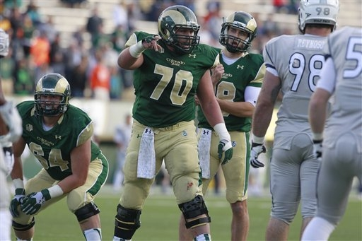Colorado State center Weston Richburg directs his linemates against Nevada in the third quarter of Colorado State's 38-17 victory in an NCAA college football game in Fort Collins, Colo., on Saturd ...