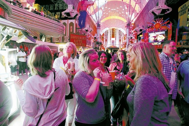 Revelers, who declined to give their names, drink at the Fremont Street Experience Friday, Oct. 4, 2013. The city won't accept applications for new package liquor stores under the Fremont Street ...
