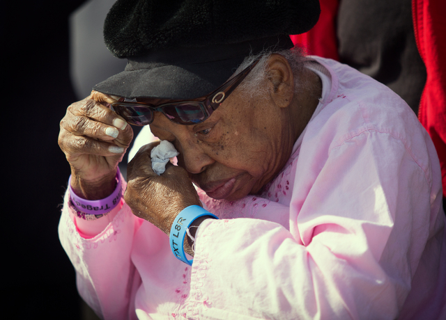 Mary Leach wipes away tears during a press conference at the intersection of Martin Luther King Boulevard and Balzar Avenue on Monday, Nov. 18, 2013. Leach's son, Judge Brooks, was killed at the n ...