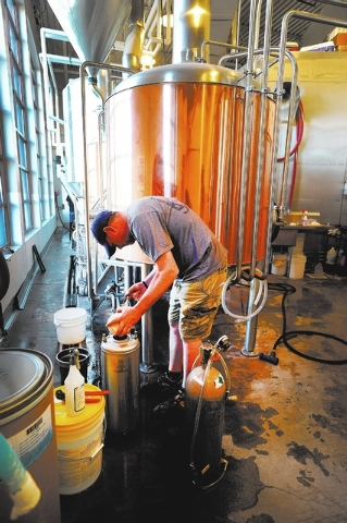 Head brewer Anthony Gibson customizes a seasonal brew  for a private party at the Tenaya Creek Brewery on Friday, Nov. 1, 2013. (David Becker/Las Vegas Review-Journal)