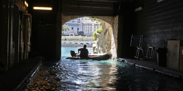 """RJ FILE*** JOHN GURZINSKI/LAS VEGAS REVIEW-JOURNAL NEWS - A worker enters a water passage known as the """"batcave"""" where crews gain access to some of the machinery for the Bellagio Fountai ..."""