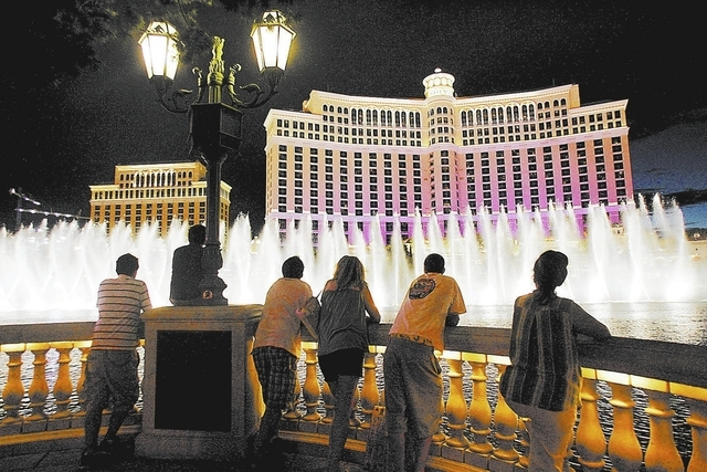 CRAIG L. MORAN/REVIEW-JOURNAL Businessu2014An exterior view of the Bellagio Hotel Casino on Las Vegas Blvd during its fountain water show Wednesday August 1, 2007.