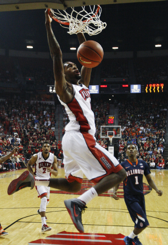 UNLV's Roscoe Smith goes in for a dunk in front of Illinois' Jaylon Tate (1) at the Thomas & Mack Center in Las Vegas on Nov. 26, 2013. (Jason Bean /Las Vegas Review-Journal)