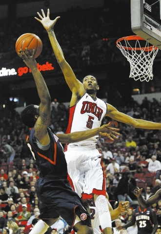 UNLV's Christian Wood (5) blocks the shot of Illinois' Tracy Abrams (13) at the Thomas & Mack Center in Las Vegas on Nov. 26, 2013. (Jason Bean /Las Vegas Review-Journal)