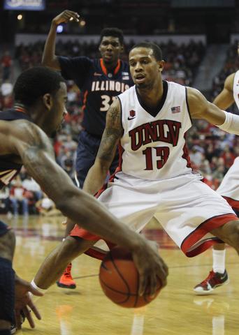 UNLV's Bryce Dejean-Jones plays defense while taking on Illinois at the Thomas & Mack Center in Las Vegas on Nov. 26, 2013. (Jason Bean /Las Vegas Review-Journal)