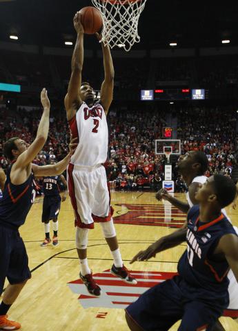 UNLV 's Khem Birch (2) goes in for a dunk against Illinois at the Thomas & Mack Center in Las Vegas on Nov. 26, 2013. (Jason Bean /Las Vegas Review-Journal)