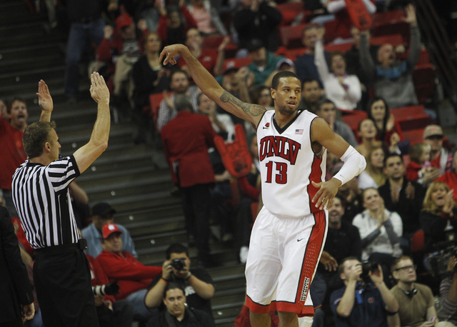 UNLV's Bryce Dejean-Jones reacts after hitting a three pointer while taking on Illinois at the Thomas & Mack Center in Las Vegas on Nov. 26, 2013. (Jason Bean /Las Vegas Review-Journal)