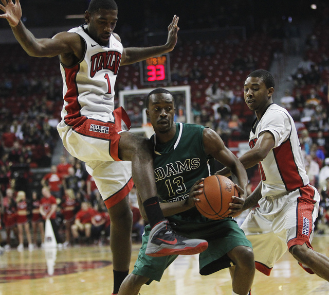 UNLV's Roscoe Smith (1) and Daquan Cook (10) double team Adams State's Rodney Nelson (13) during their exhibition basketball game at the Thomas & Mack Center in Las Vegas on Nov. 5, 2013. (Jason B ...