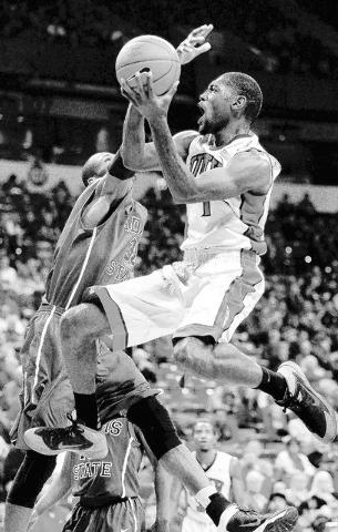 UNLV's Roscoe Smith (1) drives past Adams State's Okechukwu Arnold (32) during their exhibition basketball game at the Thomas & Mack Center in Las Vegas on Nov. 5, 2013. (Jason Bean/Las Vegas Revi ...