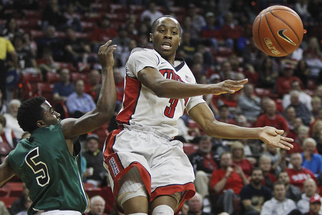 UNLV's Kevin Olekaibe (3) looks to pass while being guarded by Adams State's Lee Lark (5) during their exhibition basketball game at the Thomas & Mack Center in Las Vegas on Nov. 5, 2013. (Jason B ...