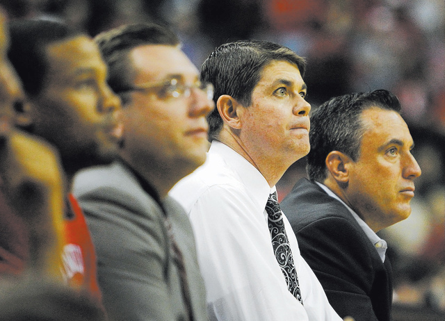 UNLV head coach Dave Rice, second from right, watches his team take on Adams State during their exhibition game at the Thomas & Mack Center on Tuesday. (Jason Bean/Las Vegas Review-Journal)