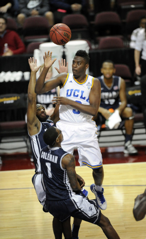 UCLA Bruins guard Jordan Adams is fouled by Nevada Wolf Pack guard Marqueze Coleman, 1, while guard Deonte Burton, right, also defends in the first half of their NCAA Basketball game in the Las Ve ...