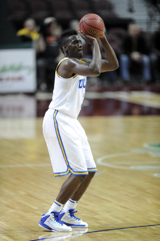 UCLA Bruins guard Jordan Adams shoots against the Nevada Wolf Pack in the first half of their NCAA Basketball game in the Las Vegas Invitational college basketball tournament at Orleans Arena in L ...