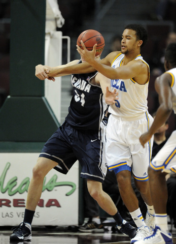 UCLA Bruins guard Kyle Anderson (5) steals the ball away from Nevada Wolf Pack forward Lucas Stivrins (34) in the first half of their NCAA Basketball game in the Las Vegas Invitational college bas ...