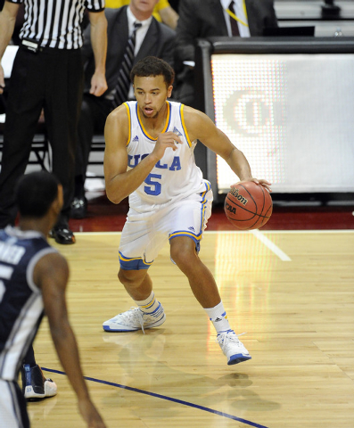 UCLA Bruins guard Kyle Anderson (5) drives to the basket against the Nevada Wolf Pack in the first half of their NCAA Basketball game in the Las Vegas Invitational college basketball tournament at ...