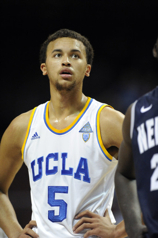 UCLA Bruins guard Kyle Anderson looks on as a Nevada Wolf Pack player shoots a free throw in the first half of their NCAA Basketball game in the Las Vegas Invitational college basketball tournamen ...