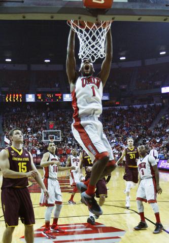 UNLV's Roscoe Smith (1) dunks while taking on Arizona State at the Thomas & Mack Center in Las Vegas on Nov. 19, 2013. (Jason Bean /Las Vegas Review-Journal)