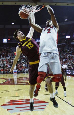 UNLV's Khem Birch dunks over Arizona State's Jordan Bachynski (13) at the Thomas & Mack Center in Las Vegas on Nov. 19, 2013. (Jason Bean /Las Vegas Review-Journal)