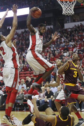 UNLV's Roscoe Smith (1) grabs a rebound while taking on Arizona State at the Thomas & Mack Center in Las Vegas on Nov. 19, 2013. (Jason Bean /Las Vegas Review-Journal)