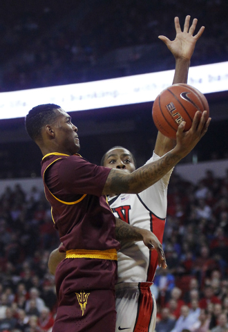 UNLV's Kevin Olekaibe (3) blocks the shot of Arizona State's Jahii Carson (1) at the Thomas & Mack Center in Las Vegas on Nov. 19, 2013. (Jason Bean /Las Vegas Review-Journal)