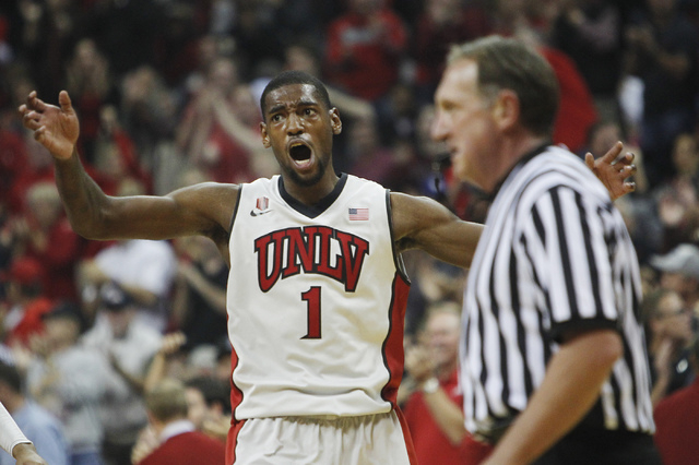 UNLV's Roscoe Smith (1) gets fired up while taking on Arizona State at the Thomas & Mack Center in Las Vegas on Nov. 19, 2013. (Jason Bean /Las Vegas Review-Journal)