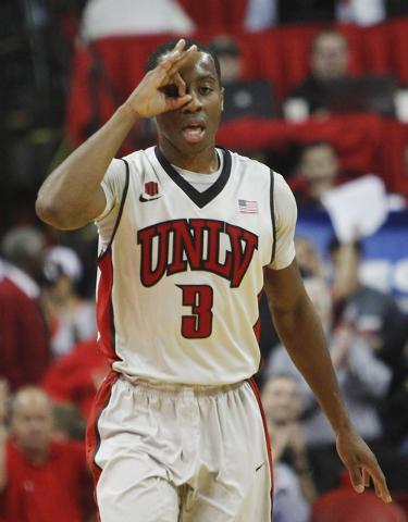 UNLV's Kevin Olekaibe (3) celebrates a three point shot while taking on Arizona State at the Thomas & Mack Center in Las Vegas on Nov. 19, 2013. (Jason Bean /Las Vegas Review-Journal)
