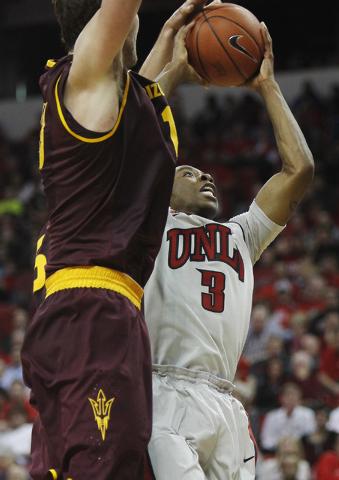 UNLV's Kevin Olekaibe (3) drives past Arizona State's Jordan Bachynski (13) at the Thomas & Mack Center in Las Vegas on Nov. 19, 2013. (Jason Bean /Las Vegas Review-Journal)