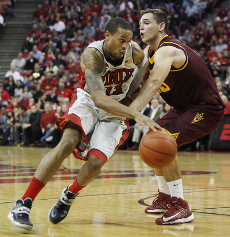 UNLV's Bryce Dejean-Jones (13) drives past Arizona State's Egor Koulechov (15)  at the Thomas & Mack Center in Las Vegas on Nov. 19, 2013. (Jason Bean /Las Vegas Review-Journal)