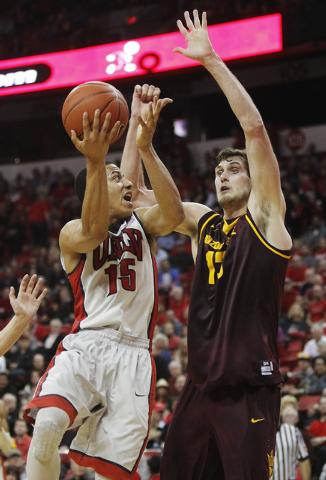 UNLV's Kendall Smith (15) drives into Arizona State's Jordan Bachynski (13) at the Thomas & Mack Center in Las Vegas on Nov. 19, 2013. (Jason Bean /Las Vegas Review-Journal)