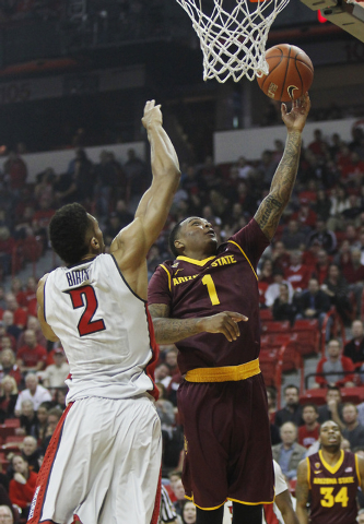 Arizona State's Jahii Carson (1) drives past UNLV's Khem Birch (2) for two of his game high 40 points at the Thomas & Mack Center in Las Vegas on Nov. 19, 2013. (Jason Bean /Las Vegas Review-Journal)