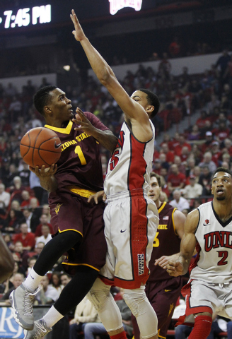 Arizona State's Jahii Carson (1) drives against UNLV's Kendall Smith (15) for two of his game high 40 points at the Thomas & Mack Center in Las Vegas on Nov. 19, 2013. (Jason Bean /Las Vegas Revie ...