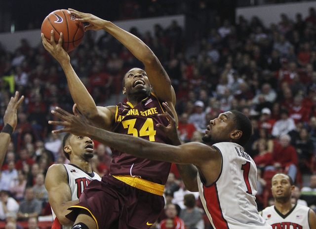 Arizona State's Jermaine Marshall (34) drives past UNLV's Khem Birch (2) and Rosce Smith (1) at the Thomas & Mack Center in Las Vegas on Nov. 19, 2013. (Jason Bean /Las Vegas Review-Journal)