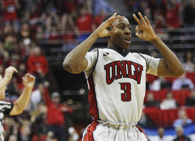 UNLV's Kevin Olekaibe celebrates a three point shot while taking on Arizona State at the Thomas & Mack Center in Las Vegas on Nov. 19, 2013. (Jason Bean /Las Vegas Review-Journal)