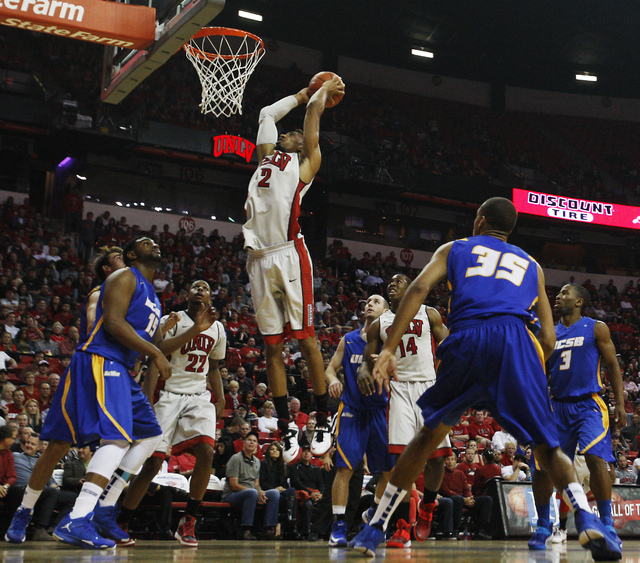 UNLV's Khem Birch (2) goes in for a dunk while taking on UCSB during their basketball game at the Thomas & Mack Center in Las Vegas on Nov. 12, 2013. (Jason Bean /Las Vegas Review-Journal)