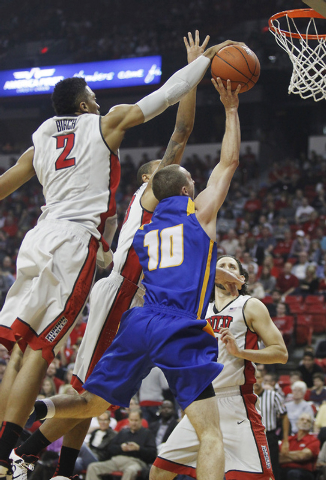 UNLV's Khem Birch (2) blocks the shot of UCSB's Kyle Boswell (10) during their basketball game at the Thomas & Mack Center in Las Vegas on Nov. 12, 2013. (Jason Bean /Las Vegas Review-Journal)