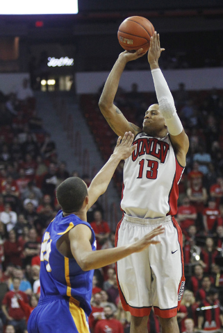 UNLV's Bryce Dejean-Jones (13) shoots a three pointer over UCSB's Michael Bryson (24)  during their basketball game at the Thomas & Mack Center in Las Vegas on Nov. 12, 2013. (Jason Bean /Las Vega ...