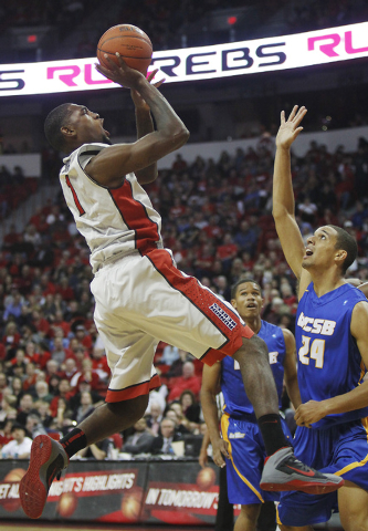 UNLV 's Roscoe Smith (1) shoots over UCSB's Michael Bryson (24) during their basketball game at the Thomas & Mack Center in Las Vegas on Nov. 12, 2013. (Jason Bean /Las Vegas Review-Journal)