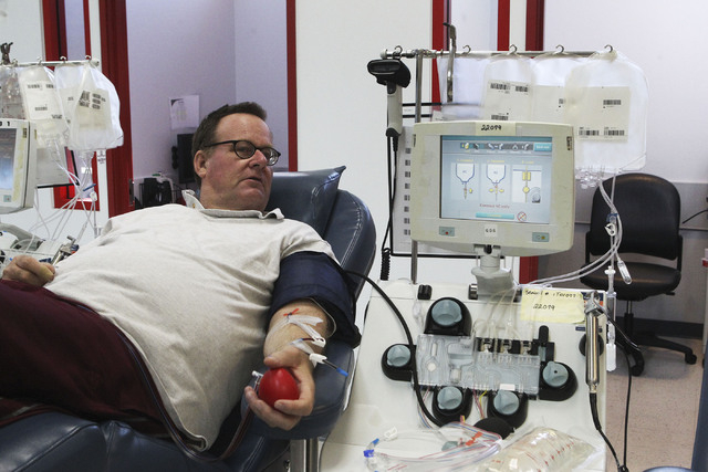 Jon Pope donates platelets at United Blood Services in Las Vegas, Monday, Nov. 11, 2013. Platelets are used in the treatment of cancer. (Jerry Henkel/Las Vegas Review-Journal)