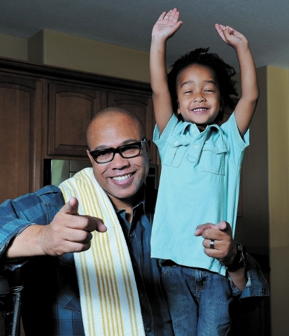 Chef Jeff Henderson poses for a portrait with three-year old son Nicholas at his home in North Las Vegas, Nev. Friday, Nov. 8, 2013. (David Cleveland/Las Vegas Review-Journal)