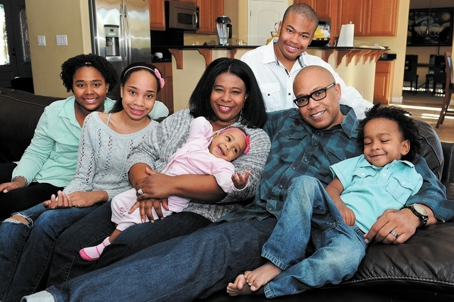 The Henderson family, from left, Troy, 11, Noel, 14, Grace, 7 months, Stacy, Jeffery Jr., 16, Chef Jeff and Nicholas, 3, pose for a family portrait at their home in North Las Vegas, Nev. Friday, N ...