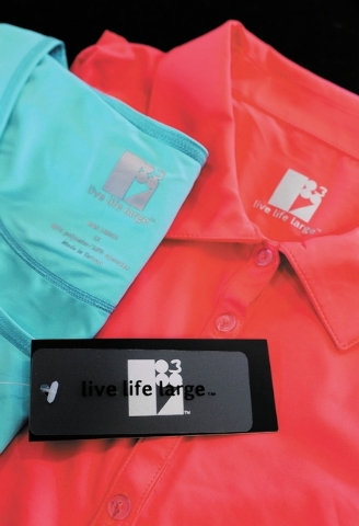 Several items from Las Vegas resident and entrepreneur Susan Merritt's Live Life Large clothing line are shown Friday, Nov. 8, 2013, in Las Vegas. Merritt's line features plus-size active w ...