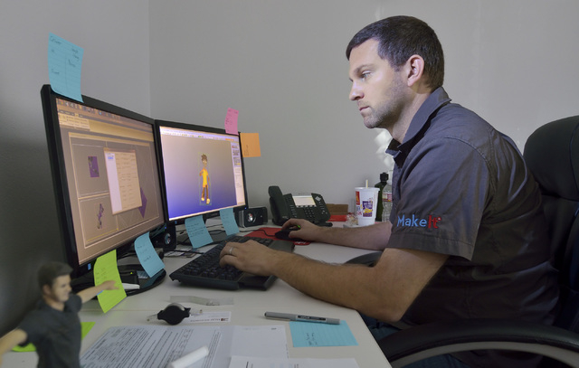 Peter Emminger, a partner at MakeIt, a 3-D printing company, works on a figurine at the firm's offices at 5075 W. Diablo Drive in Las Vegas on Wednesday, Oct. 30, 2013. The company uses a computer ...