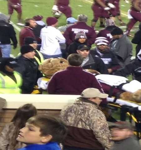 "Michaela Mills, while dressed as Mississippi State University's mascot ""Bully,"" is carted off the field after an ESPN TV cart ran over her left leg. (Courtesy of Luke Shemwell, @Lucipher_Shem/Twitter)"