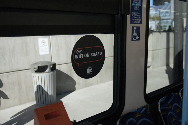 A sign informs passengers about the free Wi-Fi on board of a Centennial Express at the Bonneville Transit Center in Las Vegas Tuesday, Nov. 26, 2013. The Regional Transportation Commission is runn ...