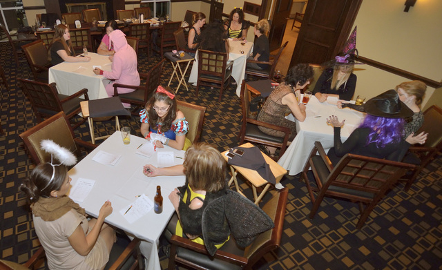 Players roll the dice during a Halloween-themed Ladies Bunco Night at the Canyon Gate Country Club at 2001 Canyon Gate Drive in Las Vegas on Thursday, Oct. 24, 2013. The group meets for the game o ...