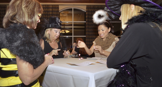 Playing bunco are, from left, Annette Lexis, Nancy Fullerton, Violet Frear and Tiffany Catron during a Halloween-themed Ladies Bunco Night at the Canyon Gate Country Club at 2001 Canyon Gate Drive ...