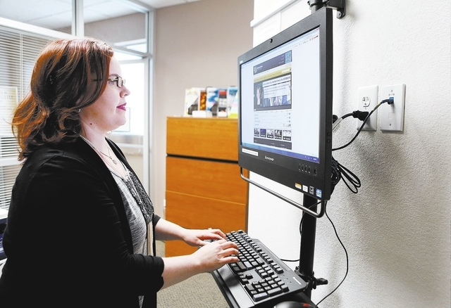 Cindy Stella, directory of the Career Services Center at Nevada State College, pages through the center's online Scorpion CareerLink portral at Nevada State College Tuesday, Oct. 29, 2013, in Hend ...