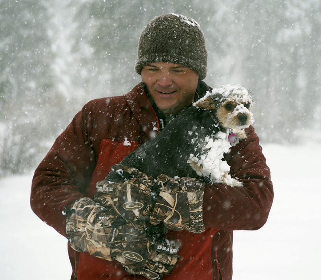Curtis Raulerson, of Las Vegas, holds his dog Maya after she got chilled in the approximately nine-inch deep snow at Lee Canyon Snow Play area on Mt. Charleston, Friday, Nov. 22, 2013.The Nevada H ...