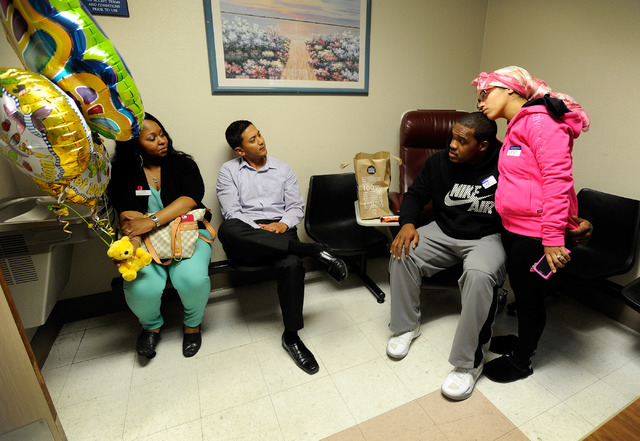 Brandon and Tiffany Ward, right, visit with friends Shimiaka Chadwick, left and Jason Cavizo in the waiting area at the University Medical Center Children's Hospital of Nevada on Tuesday, Nov. 5,  ...