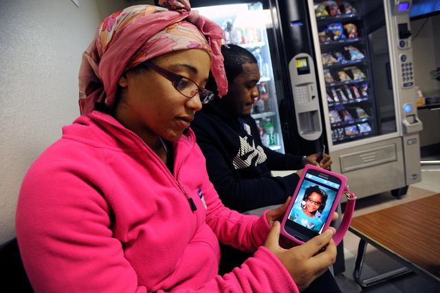 Tiffany Ward displays a photo of her daughter Brazyl Ward, 6, in the waiting area at the University Medical Center  Children's Hospital of Nevada on Tuesday, Nov. 5, 2013.  The younger Ward was cr ...